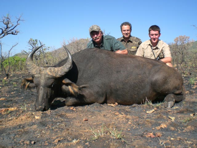Ken Wilson and the West African Savanna Buffalo he hunted with Faro East in 2009
